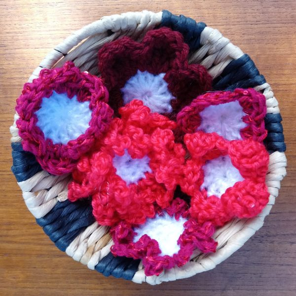 red flower brooches